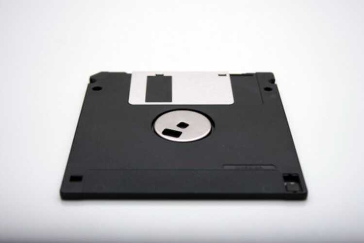 a floppy disk against a white background -- which is an attempt at a metaphor for what memoization is: storing results of functions in memory